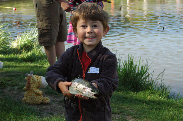 A young angler presents his catch of the day!