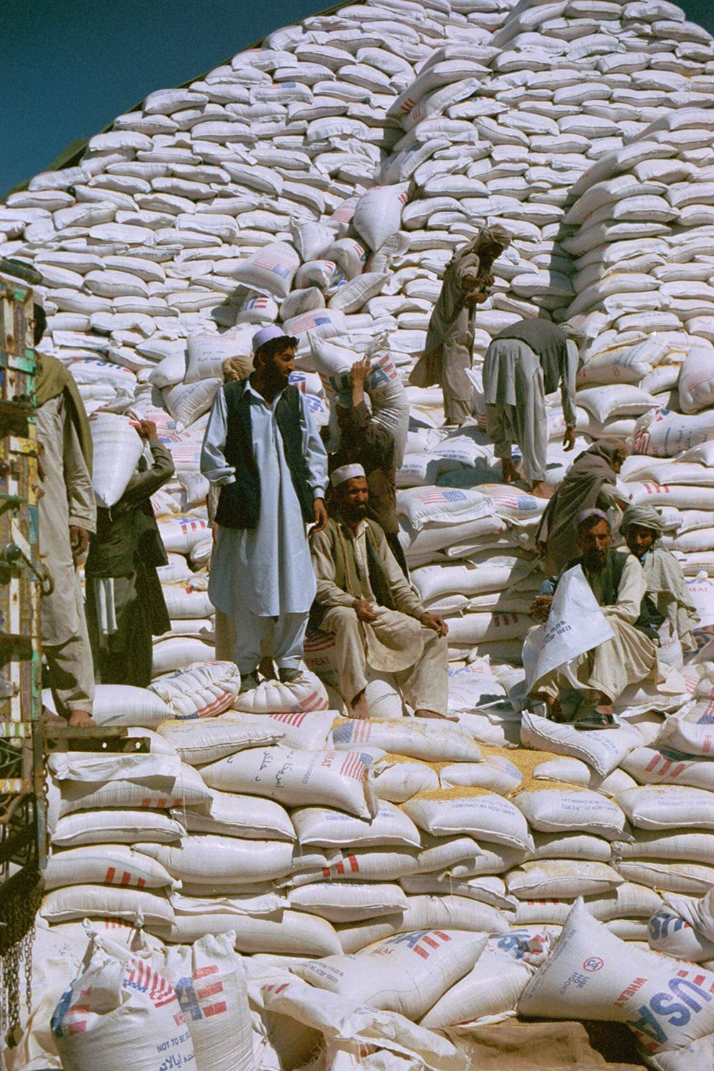 In Afghanistan, large quantities of US wheat, flown in by USAID after the fall of Taliban, drove down the price of local wheat and income of many farmers. Nitin Madhav