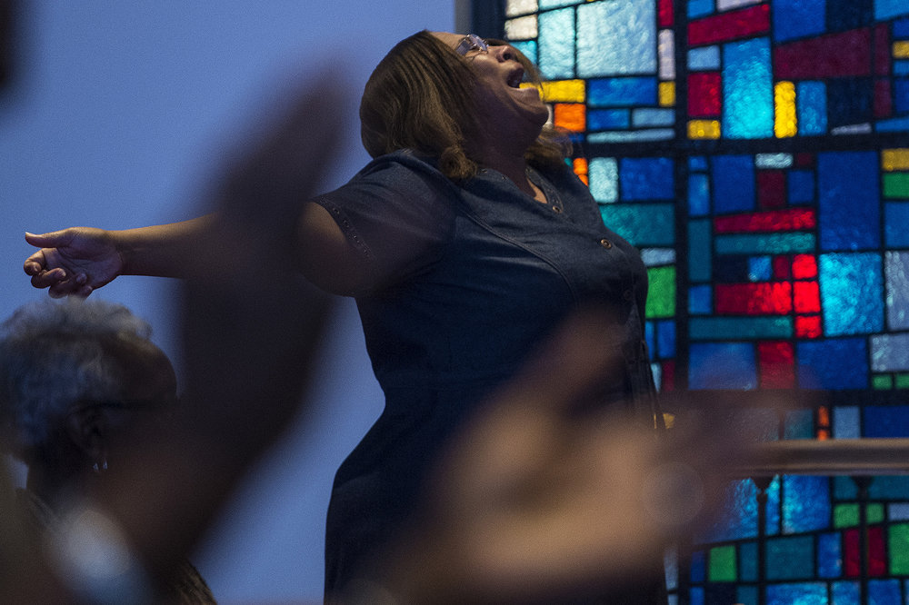 "Tammie Swinney, of Carbondale, takes part in a worship service Oct. 30 at Olivet Free Will Baptist Church in Carbondale. ""I do believe that [at] Olivet, we all love each other,"" said Olivet deacon Kent Mason. ""I mean, I can go talk to any brother, any sister and they say they'll help me. They'll do things for me. I mean that's what you want. You want to be a family. And we are a family."" This year the church celebrates 150 years in the Carbondale community. — Oct. 30, 2016, Carbondale, Illinois."