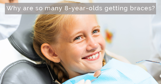 girl sitting in the orthodontic chair and smiling with the words, Why are so many 8-year-olds getting braces?