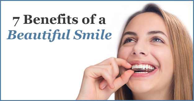 Woman smiling with aligners, with the text, 7 Benefits of a Beautiful Smile