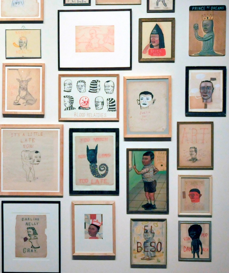 Detail of drawings and paintings on paper in vintage frames.