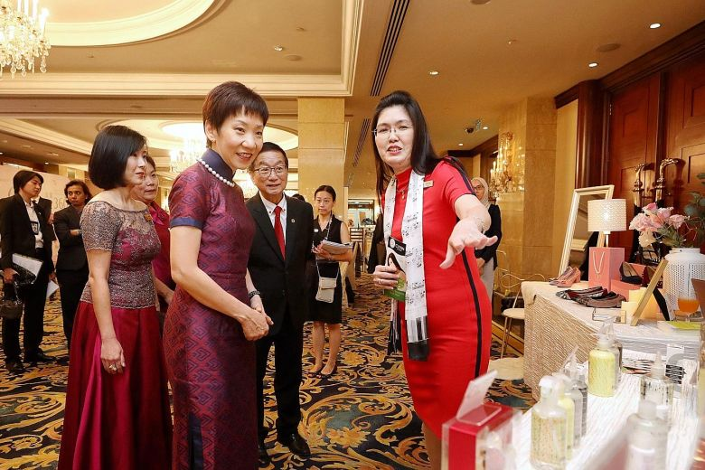 """""""Minister for Culture, Community and Youth Grace Fu speaking to Ms Lynn Yap (right), founder of personal care products brand Clynn by Nature, at her booth at Marketplace by Crib yesterday. Crib is a non-profit group that helps build business networks for women.""""  ST PHOTO: GAVIN FOO"""