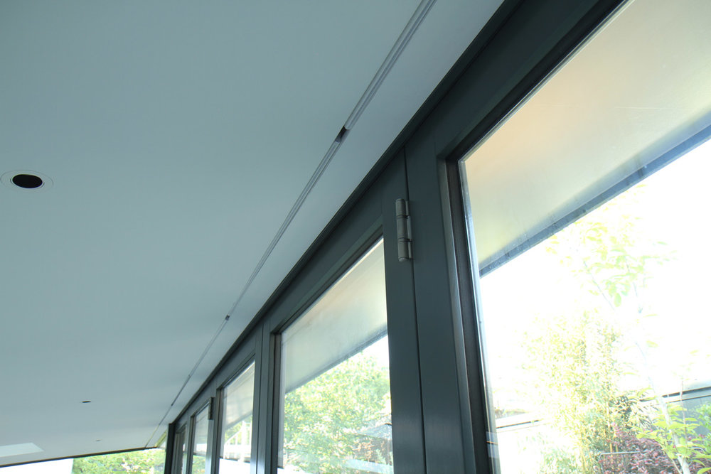 Fully concealed motorised blinds installed in front of bi-folding doors