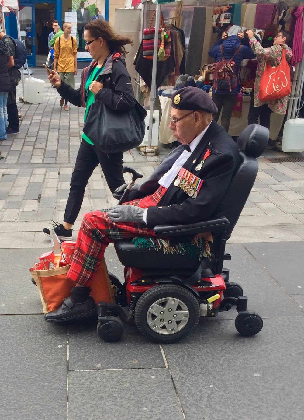 One of the many fine characters that passed me on Castle street today H had been to Sainsbury's I think looking at his full shopping bag :)