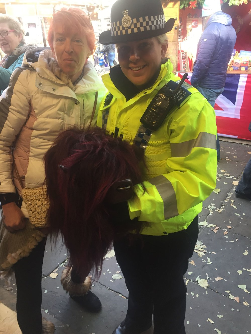PC Kate was delighted to have a cuddle whilst on the beat. Burgundy Ice bull matches the day glow yellow .