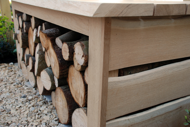 Oak bench with log store Lisa Cox Garden Designs RHS Cardiff 2015.jpg