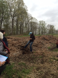 Dina discussing how she uses leaf compost as fertilizer on her farm.