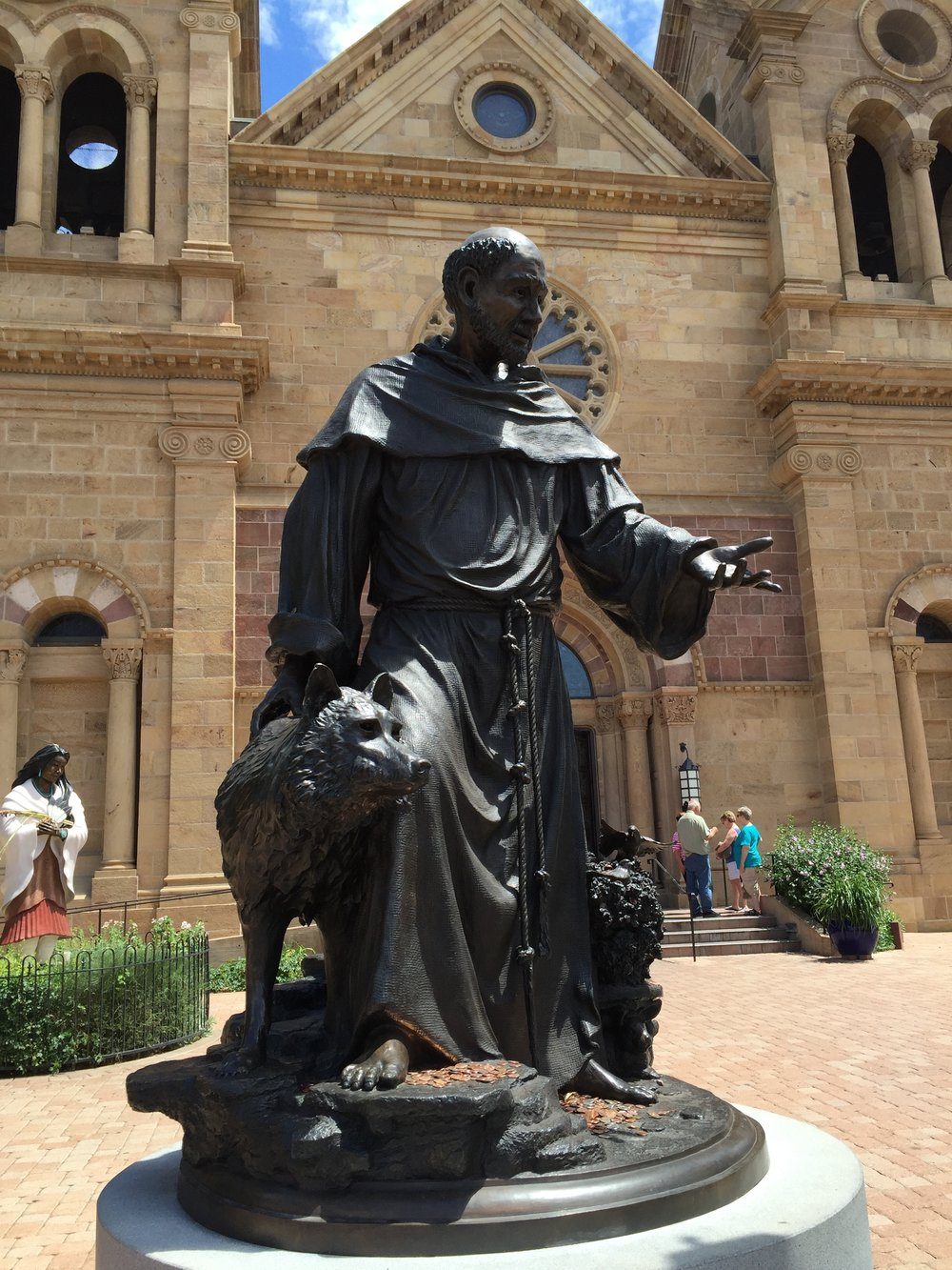 I took this picture of St. Francis and the wolf of Gubbio in Santa Fe outside The Cathedral Basilica of St. Francis of Assisi. St. Kateri Tekakwitha (the first Native American saint) is in the background.