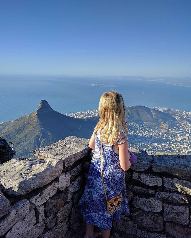 """""""Distance lends enchantment to the view."""" ~ Mark Twain // @mominzurich's daughter admired the view from Table Mountain in Cape Town, South Africa.  Table Mountain is a popular hiking destination for tourists and locals alike, and with views like this, it's easy to see why. #familyjaunts for a chance to be featured.  #getoutside #goadventure #liveauthentic #travelingfamily #ontheroad #exploreeverything #instatravel #littleexplorers #wanderlusting #travelgram #welltravelledkids #littleandbrave #kidstravel #familyadventure #showthemtheworld  #travelwithkids  #neverstopexploring #naturejaunt #tablemountain #views #southafrica #ig_southafrica #ig_africa"""