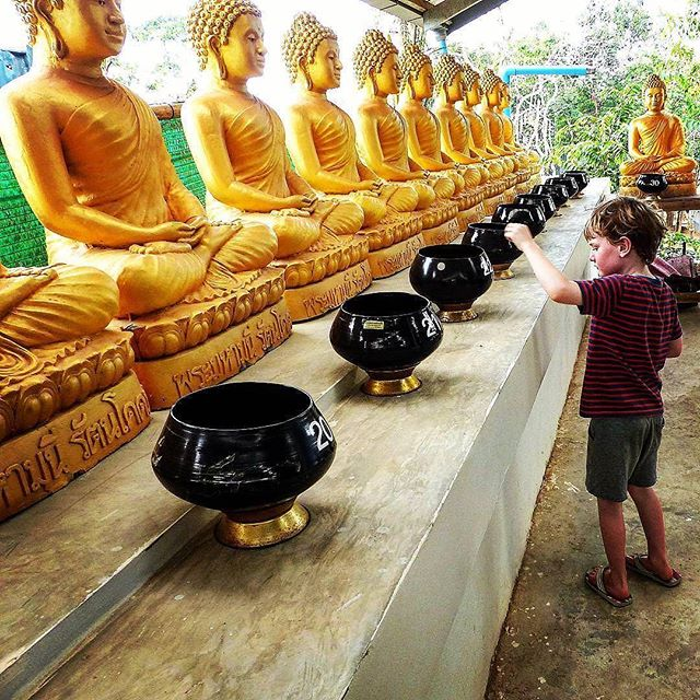 "We wholeheartedly agree with these thoughts on travel from @thewanderingmum: ""One of my favourite things about traveling with a child is showing him other cultures and religions and in turn hopefully raising a great little global citizen who embraces everyone regardless of their background....Here he is giving alms at a Buddhist temple in Thailand."" ----  Tag your best #familytravel pictures with #familyjaunts for a chance to be featured.  #getoutside #goadventure #liveauthentic #travelingfamily #ontheroad #exploreeverything #instatravel #littleexplorers #wanderlusting #travelgram #welltravelledkids #littleandbrave #kidstravel #familyadventure #showthemtheworld  #travelwithkids  #neverstopexploring #culturejaunt"