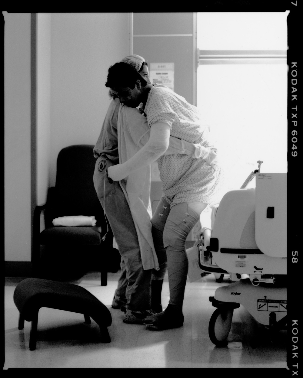 Nurse helping patient, Burn Center, New York Cornell Hospital