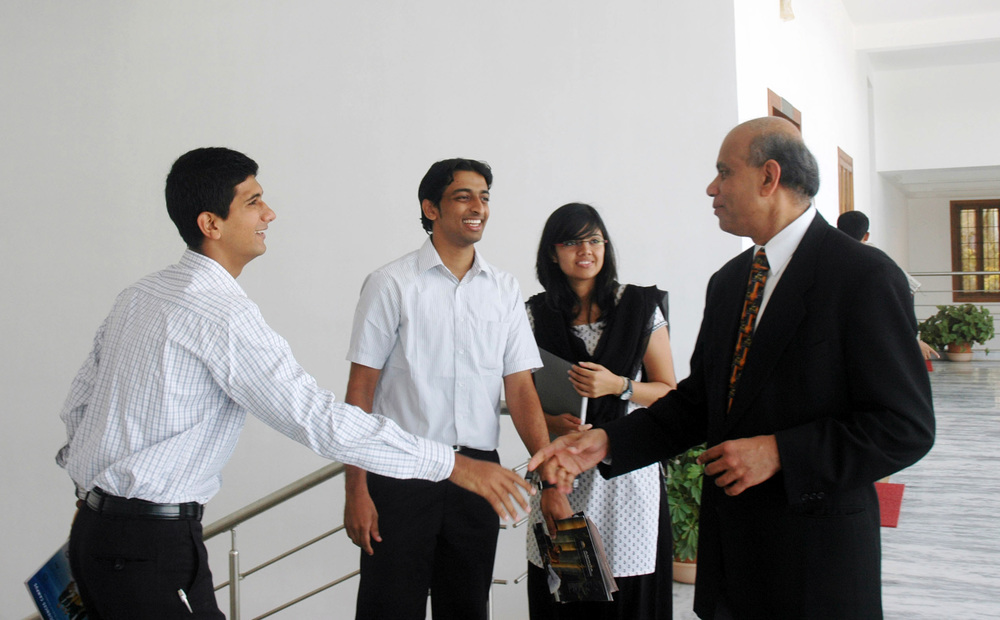 Dr. Gurumurthy Kalyanaram with students.