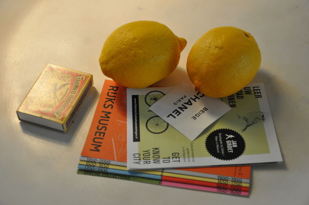 Box of matches, two lemons and Amsterdam guide books
