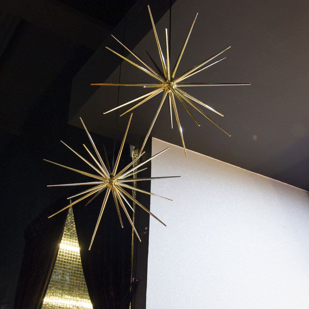 Gold satellite stars hanging in from restaurant ceiling