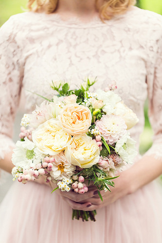 Small bridal bouquet in blush tones with garden roses, dahlias and scabiosa