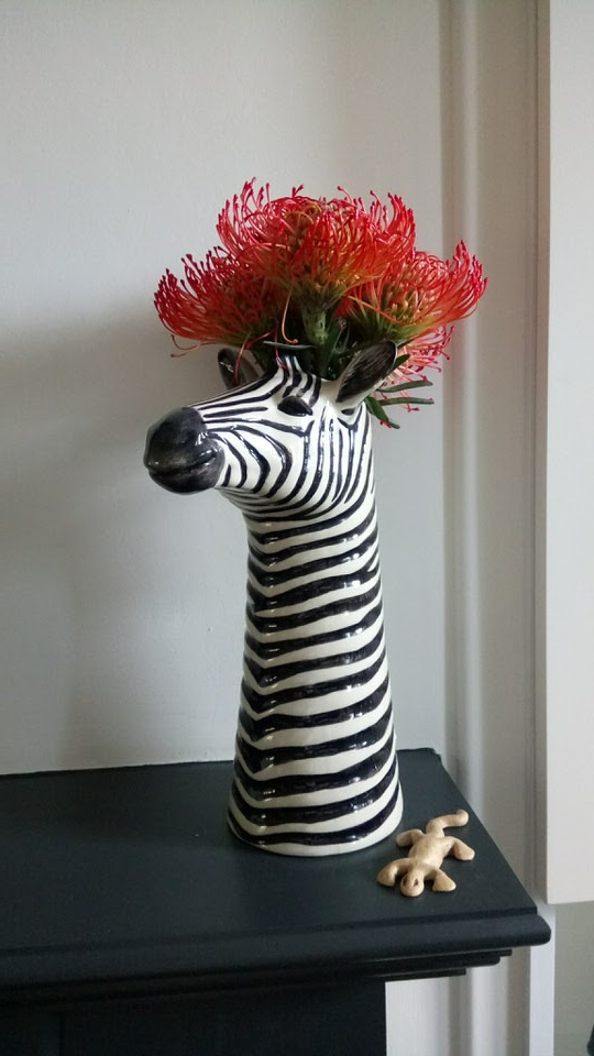 zebra head vase with red pin cushion protea