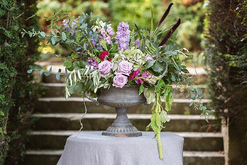 Urn arrangement with seasonal flowers