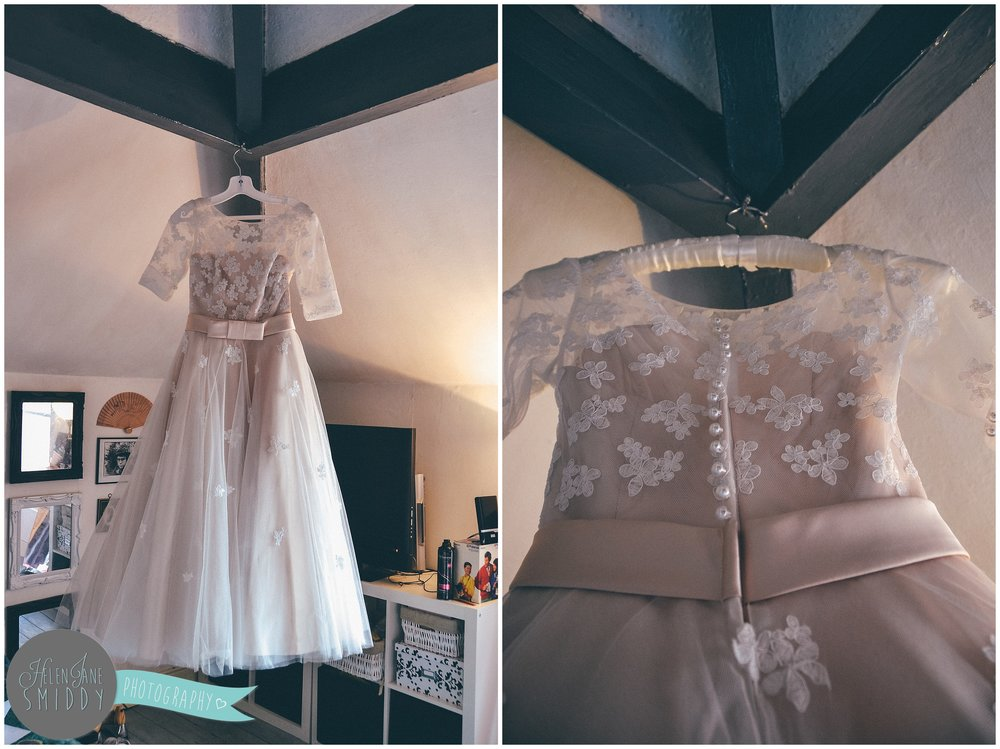 Wedding gown hung up on a wedding morning.