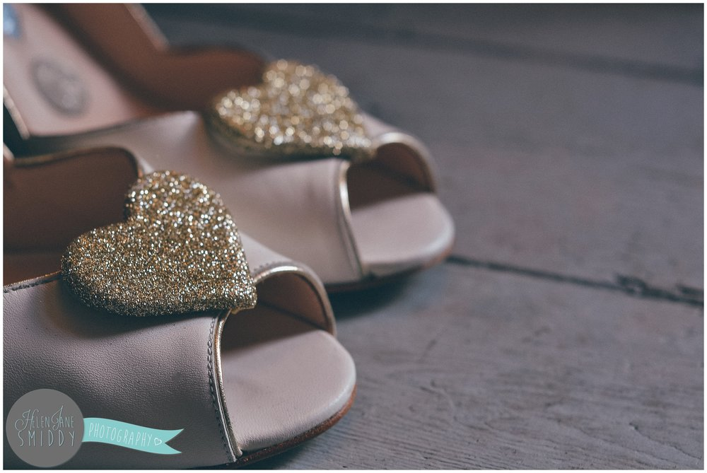 Charlotte Mills wedding shoes with gold glittery hearts.