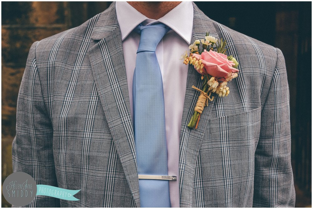 Groom's grey tweed wedding suit