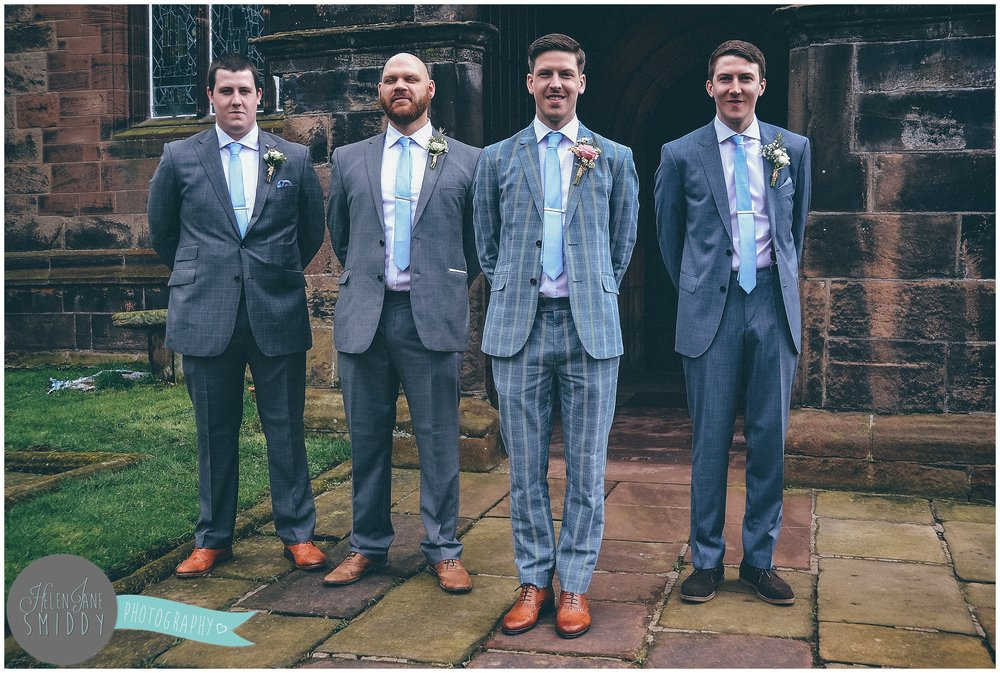 Groomsmen smartly dressed outside St Lawrence's Church in Frodsham.