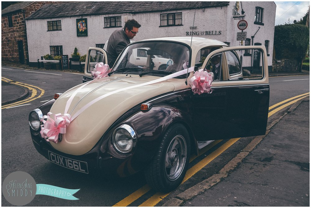 A bride chose a vintage Volswagon Beetle as her wedding car.