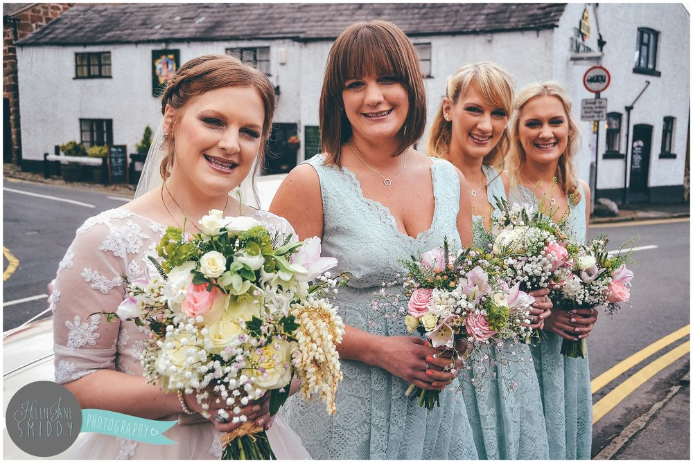 The bridal party in stunning green lace dresses.