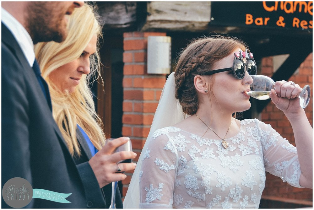 Having fun with sunglasses on her wedding day.