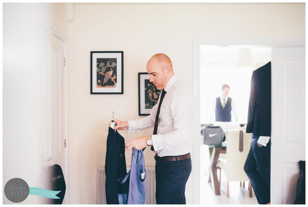 Groom gets ready on the morning of his wedding in his Best Man's house.