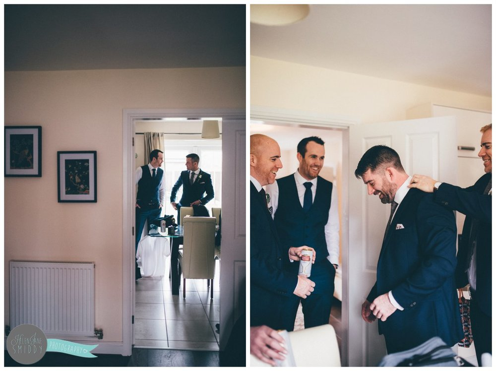 The groomsmen enjoy the preparation on the wedding morning in Cheshire.