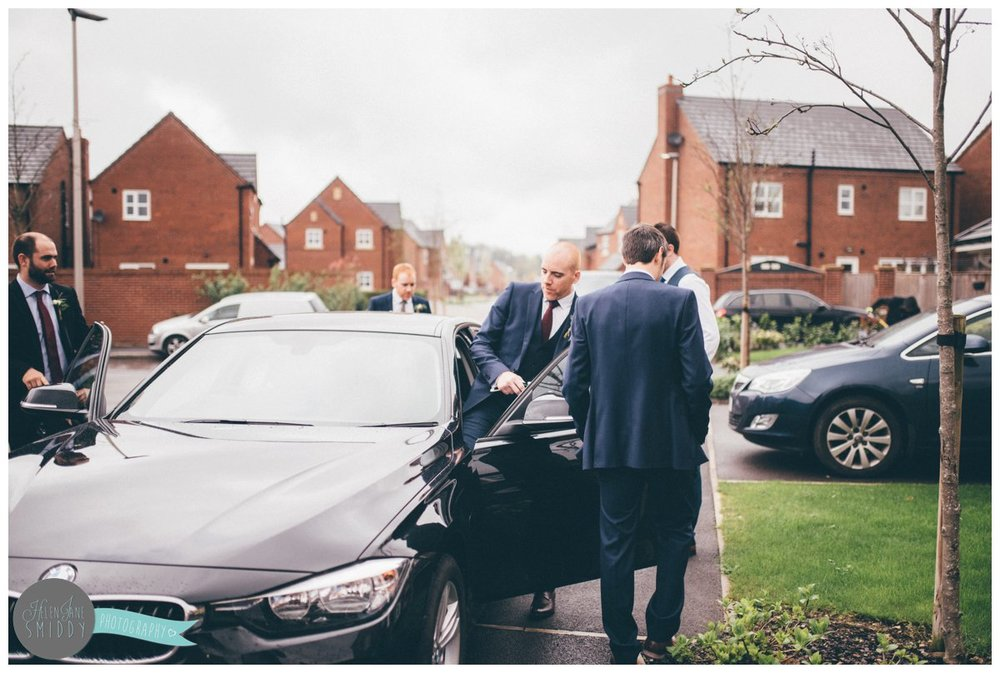 The groom gets into his Best Man's BMW to travel to his wedding in Knutsford.