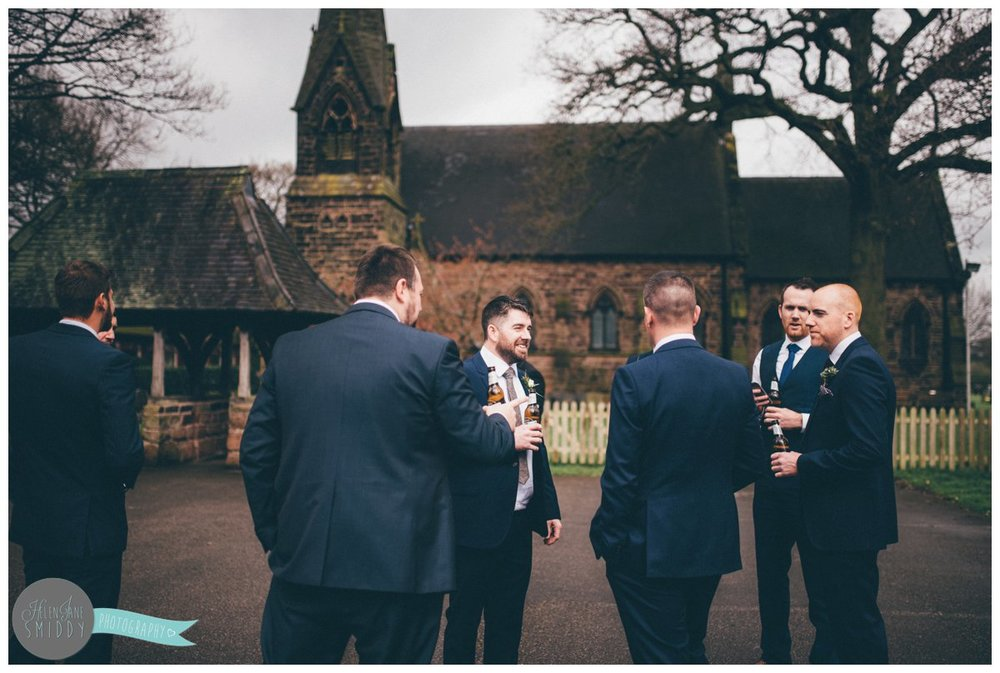 The groomsmen all stand and before the wedding ceremony in Knutsford, Cheshire.