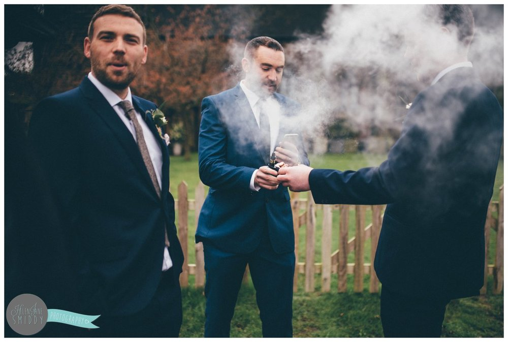 The wedding guest gets caught up in all the smoke from his E-cig.