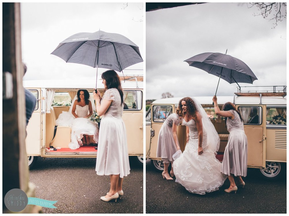 The beautiful bride arrives at Toft church in a camper van.
