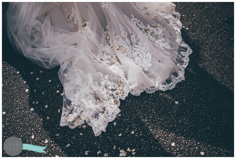 The train of Lyssa's Maggie Sottero gown was covered in confetti after the guests had thrown it at her.