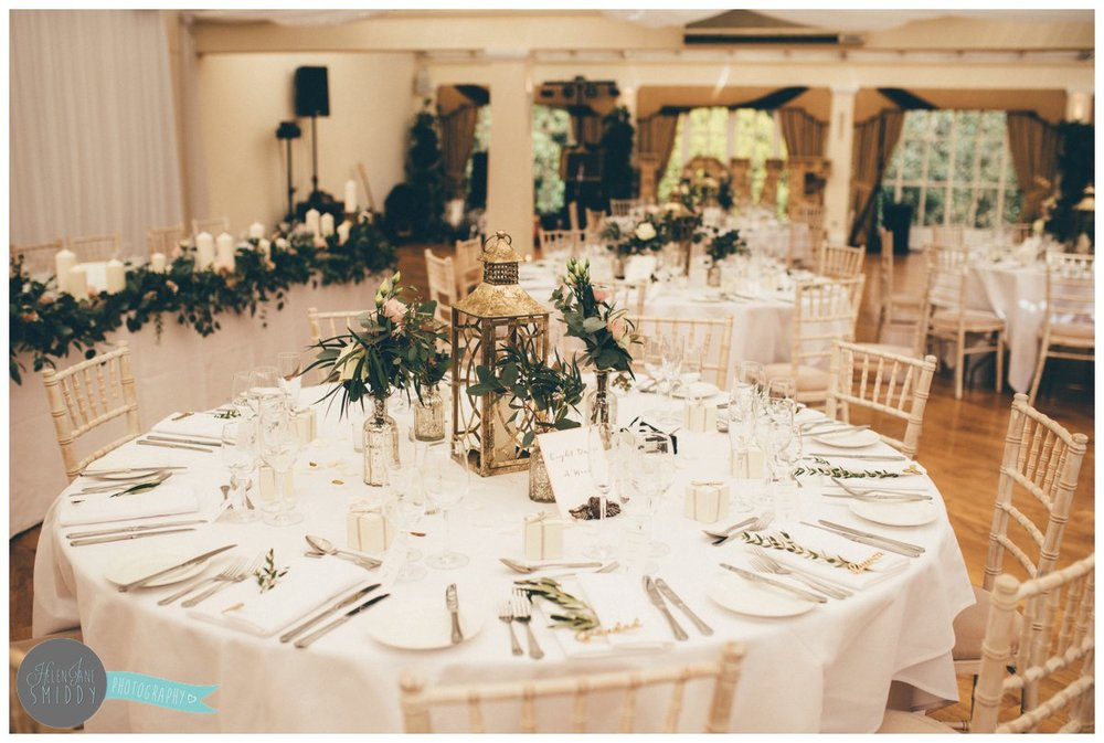 The table was decorated with beautiful greenery and rustic woodwork.