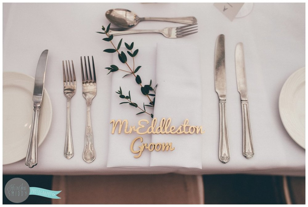 The groom's place setting was a wooden cut out of his name, sprayed golden.