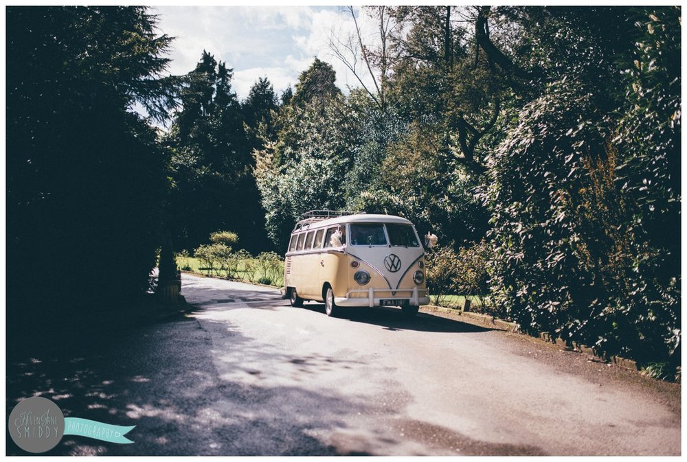 The vintage camper van arrives with the bride and groom in at Mere Court Hotel.