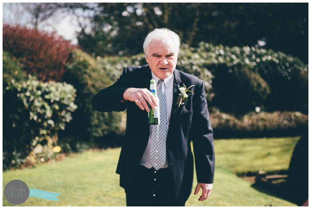 The father of the groom has a beer to celebrate and spills it!