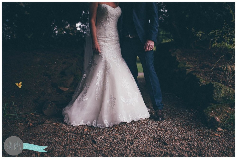 The details of Lyssa and Dom's wedding outfits compliment each other on their wedding day at Mere Court Hotel in Knutsford.