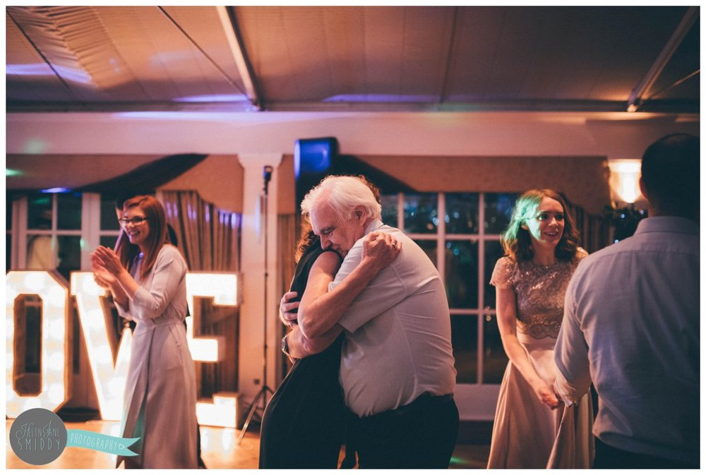 The bride's mum and dad share a dance at Mere Court Hotel.