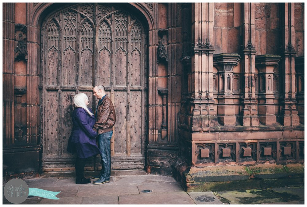 The stunning wooden archway of Chester Cathedral makes the perfect backdrop for an engagement shoot.