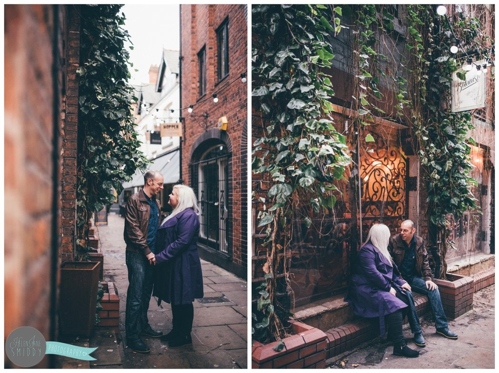 The pre-wedding shoot of Alan and Joanna in Chester City Centre against the greenery in the alleyway next to the Botanist.