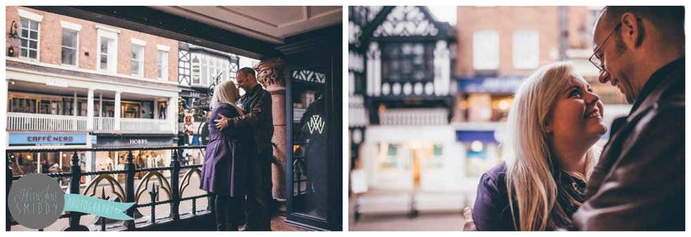 The couple stand on the rows against the railings in Chester, Cheshire.