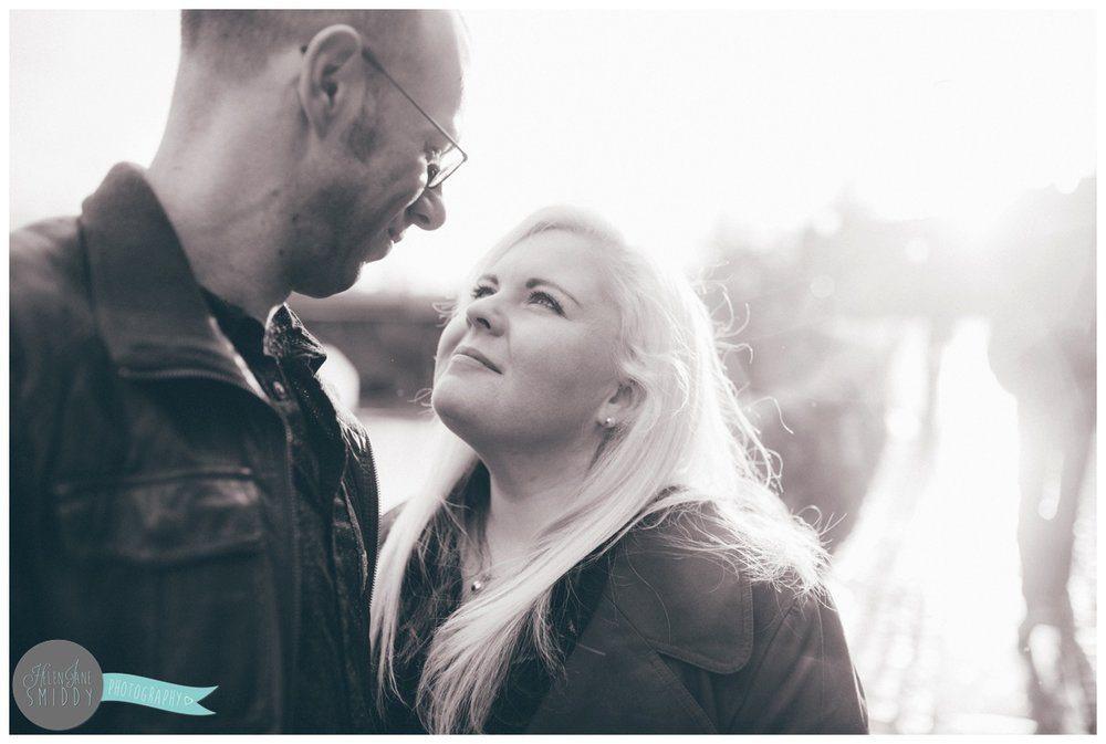 Close-up of Jo and Alan looking at each other in Chester City Centre during their engagement shoot.