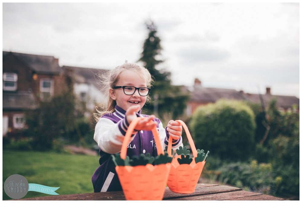 Isla picks up the baskets for the Frodsham Easter Egg hunt.