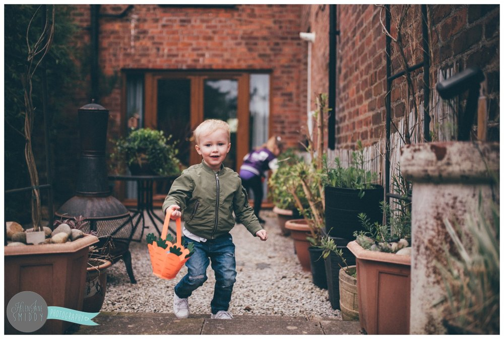 Little boy runs through the garden to find more Easter Eggs.