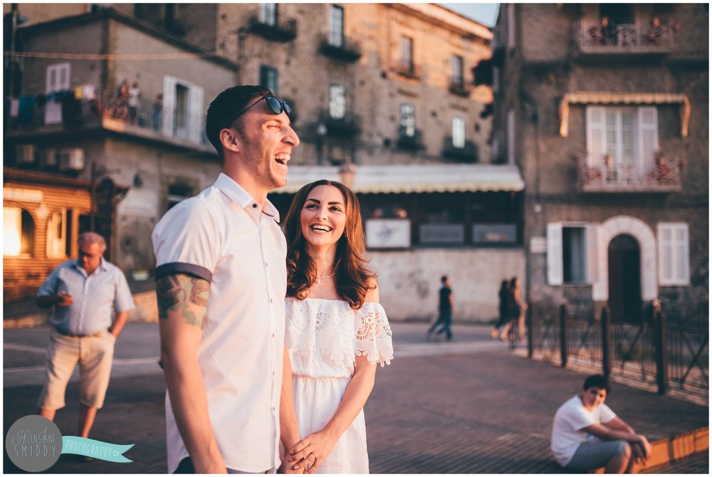 Sabrina laughs at Dom's joke during their pre-wedding shoot in rural Italy.