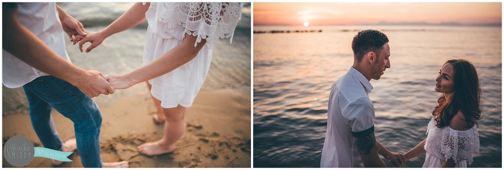 Sabrina and Dom watch the sunset on the beach in Santa Maria di Castellabate for their pre-wedding photoshoot.